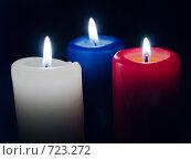 Купить «Три горящих свечи на черном фоне», фото № 723272, снято 25 февраля 2009 г. (c) Кирпинев Валерий / Фотобанк Лори