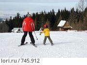 Купить «Мальчик с инструктором учится кататься на горных лыжах», фото № 745912, снято 2 марта 2009 г. (c) Юлия Кузнецова / Фотобанк Лори