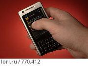 Купить «Нажатие пальцем на экран мобильного телефона», фото № 770412, снято 25 марта 2009 г. (c) Вячеслав Кондауров / Фотобанк Лори