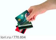 Купить «Рука берущая кредитную карту», фото № 770804, снято 25 марта 2009 г. (c) Олег Юрмашев / Фотобанк Лори