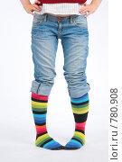 Купить «Женские ноги в джинсах и полосатых гольфах», фото № 780908, снято 19 августа 2018 г. (c) Losevsky Pavel / Фотобанк Лори