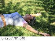 Купить «Женщина лежит на траве», фото № 781040, снято 6 февраля 2009 г. (c) Морозова Татьяна / Фотобанк Лори