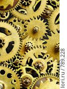 Механизм из золотых шестеренок. Стоковое фото, фотограф Андрей Армягов / Фотобанк Лори
