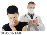 Купить «Девушка, сморкающаяся в бумажный платочек, и врач в маске, подготавливающий шприц. Белый фон», фото № 824828, снято 8 февраля 2009 г. (c) Надежда Щур / Фотобанк Лори