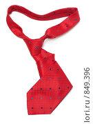Купить «Красный шелковый галстук на белом фоне», фото № 849396, снято 4 мая 2009 г. (c) Руслан Кудрин / Фотобанк Лори