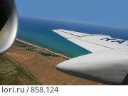 Купить «Крыло самолета на фоне моря», фото № 858124, снято 5 июля 2008 г. (c) Евгений / Фотобанк Лори