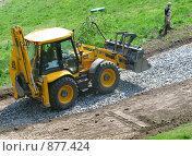 Купить «Трактор в парке», фото № 877424, снято 2 мая 2009 г. (c) Юлия Подгорная / Фотобанк Лори