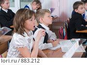 Купить «Школьники четвертого класса на уроке», фото № 883212, снято 7 мая 2009 г. (c) Федор Королевский / Фотобанк Лори