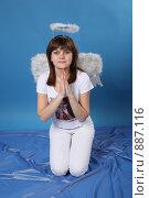 Купить «Девушка в костюме ангела», фото № 887116, снято 3 мая 2009 г. (c) Евгений Батраков / Фотобанк Лори