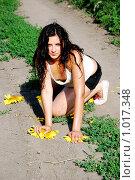 Купить «Девушка в подсолнухах», фото № 1017348, снято 22 июля 2008 г. (c) Мария Виноградова / Фотобанк Лори