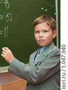 Купить «Школьник решает примеры на уроке математики», фото № 1047940, снято 20 августа 2009 г. (c) Оксана Гильман / Фотобанк Лори