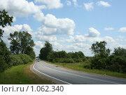 Купить «Облака над дорогой», фото № 1062340, снято 12 июля 2009 г. (c) Сергей Тундра / Фотобанк Лори
