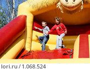 Купить «Дети на надувном аттракционе», фото № 1068524, снято 22 августа 2009 г. (c) Михаил Яковлев (ktynzq) / Фотобанк Лори