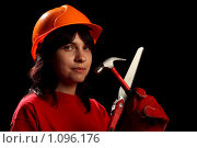 Купить «Молодая девушка в каске с молотком и ножовкой, на черном фоне», фото № 1096176, снято 17 июня 2008 г. (c) Александр Паррус / Фотобанк Лори