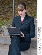 Купить «Девушка с ноутбуком на лестнице», фото № 1144092, снято 10 октября 2009 г. (c) Сергей Шумаков / Фотобанк Лори