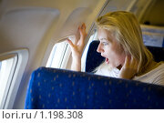 Купить «Удивленная девушка в самолете», фото № 1198308, снято 13 июля 2008 г. (c) Владимир Сурков / Фотобанк Лори