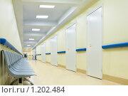 Купить «Длинный коридор со стульями в больнице», фото № 1202484, снято 25 октября 2009 г. (c) Beerkoff / Фотобанк Лори