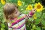 Маленькая девочка с подсолнухами, фото № 1230032, снято 5 августа 2009 г. (c) Losevsky Pavel / Фотобанк Лори