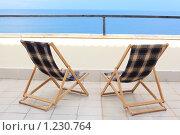Купить «Два шезлонга на веранде у моря», фото № 1230764, снято 5 июля 2009 г. (c) Losevsky Pavel / Фотобанк Лори