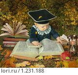 Купить «Маленький мальчик среди книг в осеннем парке», фото № 1231188, снято 20 января 2019 г. (c) Losevsky Pavel / Фотобанк Лори