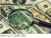 Купить «Фон из долларовых купюр под лупой», фото № 1247332, снято 3 ноября 2009 г. (c) Игорь Соколов / Фотобанк Лори