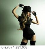 Купить «Молодая танцующая девушка в шляпе. Студийное модное фото», фото № 1281008, снято 20 ноября 2009 г. (c) Майер Георгий Владимирович / Фотобанк Лори