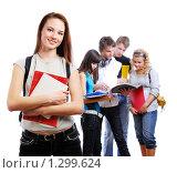 Купить «Улыбающиеся молодые люди, изолированные на белом фоне, девушка на переднем плане», фото № 1299624, снято 14 ноября 2008 г. (c) Валуа Виталий / Фотобанк Лори