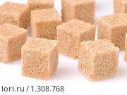 Купить «Кусочки тростникового сахара на белом фоне», фото № 1308768, снято 6 декабря 2009 г. (c) Денис Ларкин / Фотобанк Лори
