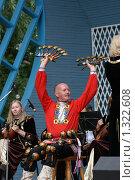 Исполнитель играет на ложках (2009 год). Редакционное фото, фотограф Алина Щедрина / Фотобанк Лори