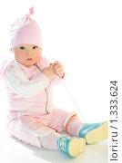 Купить «Маленькая девочка в розовом костюме», фото № 1333624, снято 26 декабря 2009 г. (c) Иванова Виктория / Фотобанк Лори