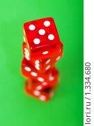 Купить «Красные кости на зеленом фоне», фото № 1334680, снято 14 марта 2009 г. (c) Elnur / Фотобанк Лори