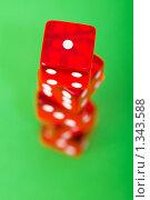 Купить «Красные кости на зеленом фоне», фото № 1343588, снято 14 марта 2009 г. (c) Elnur / Фотобанк Лори