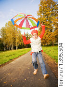 Купить «Маленькая девочка с зонтиком в парке», фото № 1395504, снято 30 сентября 2008 г. (c) Andrejs Pidjass / Фотобанк Лори