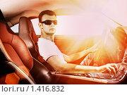 Купить «Парень за рулем спортивного автомобиля», фото № 1416832, снято 5 июня 2008 г. (c) Andrejs Pidjass / Фотобанк Лори
