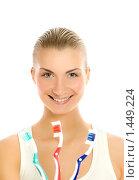 Купить «Красивая молодая женщина с тремя зубными щетками», фото № 1449224, снято 23 октября 2019 г. (c) Andrejs Pidjass / Фотобанк Лори