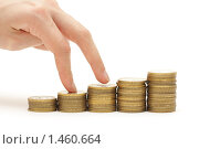 Купить «Концепция - график, сделанный из монет», фото № 1460664, снято 27 января 2010 г. (c) Евгений Дубинчук / Фотобанк Лори