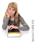 Купить «Задумчивая девушка с толстой книгой», фото № 1476112, снято 4 февраля 2010 г. (c) Валерий Александрович / Фотобанк Лори