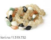 Купить «Крупные бусы из разных камней на белом фоне», фото № 1519732, снято 8 января 2010 г. (c) Милана Харитонова / Фотобанк Лори