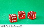 Купить «Красные игральные кости на зеленом поле», фото № 1552624, снято 11 марта 2010 г. (c) Анфимов Леонид / Фотобанк Лори