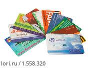 Купить «Несколько дисконтных карт на белом фоне», эксклюзивное фото № 1558320, снято 16 марта 2010 г. (c) Бондаренко Олеся / Фотобанк Лори