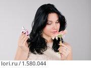 Купить «Девушка сравнивает запах духов и цветка», фото № 1580044, снято 3 марта 2010 г. (c) Okssi / Фотобанк Лори