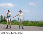 Купить «Две девушки катаются на роликах», фото № 1599092, снято 14 июня 2009 г. (c) Яков Филимонов / Фотобанк Лори