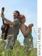 Купить «Счастливая пара среднего возраста на цветущем лугу», фото № 1605052, снято 28 июня 2009 г. (c) Иван Бондаренко / Фотобанк Лори