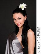 Купить «Девушка c белой лилией», фото № 1616824, снято 3 марта 2010 г. (c) Okssi / Фотобанк Лори
