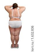Купить «Женщина с ожирением на весах», фото № 1632836, снято 25 апреля 2009 г. (c) Михаил Коханчиков / Фотобанк Лори