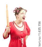 Купить «Сумасшедшая домохозяйка на белом фоне», фото № 1635156, снято 11 октября 2009 г. (c) Яков Филимонов / Фотобанк Лори