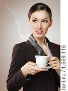 Купить «Деловая женщина с чашкой ароматного кофе», фото № 1669116, снято 20 апреля 2010 г. (c) Константин Юганов / Фотобанк Лори