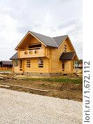 Строительство деревянного коттеджа. Стоковое фото, фотограф Миняева Ольга / Фотобанк Лори