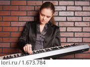 Купить «Городской музыкант», фото № 1673784, снято 22 января 2010 г. (c) Александр Егорин / Фотобанк Лори