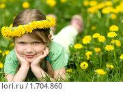 Купить «Девочка в одуванчиках», фото № 1704860, снято 13 мая 2010 г. (c) Юлия Шилова / Фотобанк Лори